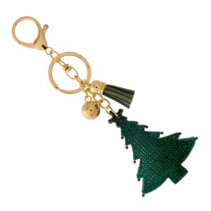 Gold tone keychain and bag charm with a Christmas tree.