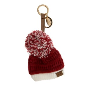 "The original C.C beanie style keychain and bag charm, with a two tone pom pom, in gameday colors. 9"" in total length."