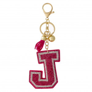 """Pink """"J"""" initial pillow keychain/bag charm featuring rhinestone details and a tassel accent. Initial approximately 2.5"""". Approximately 6"""" in length overall."""