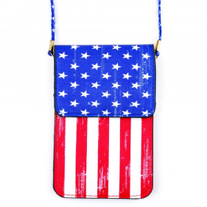 "Faux leather cross body bag with inside pocket and snap closure. Features a clear back pocket and American flag print. Approximately 7"" x 5"" in size."