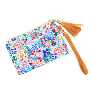 """Flower wallet/ clutch with wristlet. Pu exterior- Polyester interior. 7x5"""" in length."""