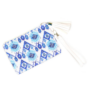 """Ikat wallet/ clutch with wristlet. Pu exterior- Polyester interior. 7x5"""" in length."""