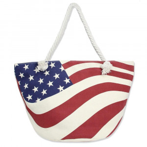 """Canvas tote bag with an American flag pattern, top zipper closure, rope handles and a lining inside with pockets. 35% cotton and 65% polyester. Measures approximately 21"""" x 13"""" in size."""