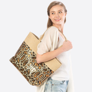 Animal print sequin bag with inside pockets. 100% polyester. Approximate 19x12 in length.