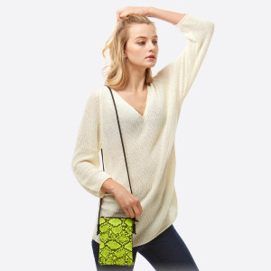 """Snakeskin print crossbody bag featuring:  - No inside pockets - One outside pocket  - Approximately 6"""" W x 8"""" T  - 100% PU"""