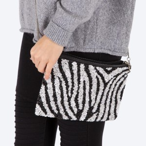 """High quality seed beaded sequins zebra print handbag.  - Zipper closure - One inside open pocket - Inside lining 100% Cotton - Approximately 10.5"""" W x 7"""" T - Strap approximately 52"""" L - Approximately 62"""" L overall - 40% Seed beads, 40% Cotton Canvas, 20% Metal"""