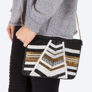 """High quality black, gold and white geometric seed beaded handbag.  - Zipper closure - One inside open pocket - Inside lining 100% Cotton - Approximately 10.5"""" W x 7"""" T - Strap approximately 52"""" L - Approximately 62"""" L overall - 40% Seed beads, 40% Cotton Canvas, 20% Metal"""