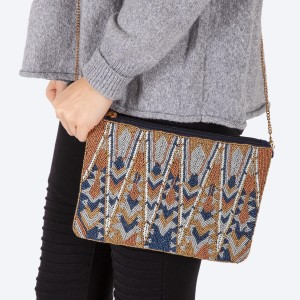 "High quality blue multicolor geometric seed beaded handbag.  - One inside open pocket - Inside lining 100% Cotton - Approximately 10.5"" W x 7"" L - Strap approximately 52"" L - Approximately 62"" L overall - 40% Seed beads, 40% Cotton Canvas, 20% Metal"