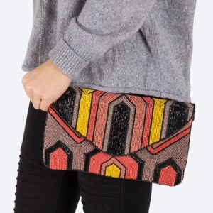 """High quality multicolor seed beaded handbag.  - Fold over snap button closure - One inside open pocket - Inside lining 100% Cotton - Approximately 10.5"""" W x 6"""" T - Strap approximately 52"""" L - Approximately 62"""" L overall - 40% Seed beads, 40% Cotton Canvas, 20% Metal"""