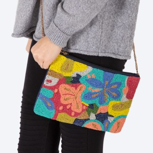 "High quality multicolor seed beaded floral print handbag.  - Zipper closure - One inside open pocket - Inside lining 100% Cotton - Approximately 10.5"" W x 7"" T - Strap approximately 52"" L - Approximately 62"" L overall - 40% Seed beads, 40% Cotton Canvas, 20% Metal"