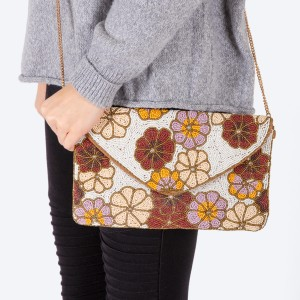 "High quality seed beaded floral print handbag.  - Fold over snap button closure - One inside open pocket - Inside lining 100% Cotton - Approximately 10.5"" W x 6"" T - Strap approximately 52"" L - Approximately 62"" L overall - 40% Seed beads, 40% Cotton Canvas, 20% Metal"