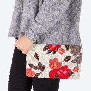 """High quality seed beaded flower print handbag.  - Fold over snap button closure - One inside open pocket - Inside lining 100% Cotton - Approximately 10.5"""" W x 6"""" T - Strap approximately 52"""" L - Approximately 62"""" L overall - 40% Seed beads, 40% Cotton Canvas, 20% Metal"""