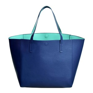 "Large navy blue tote made of PU leather. This tote is also reversible with a mint green inside. Handle drop is 11"" and this tote measures 23 x 13 x 7.5"