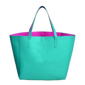 "Large turquoise tote made of PU leather. This tote is also reversible with a fuchsia inside. Handle drop is 11"" and this tote measures 23 x 13 x 7.5"