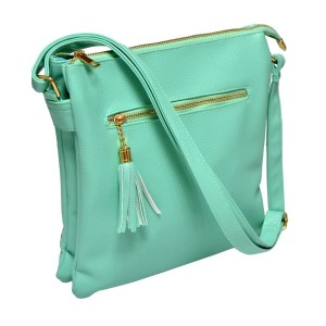 Mint green cross body bag features a front zipper pocket with three inner compartments and adjustable strap. The inside has two small pockets and one small zipper compartment. This bag is perfect for monograming, made of PU leather, and measures 10 x 11 x 2.5.