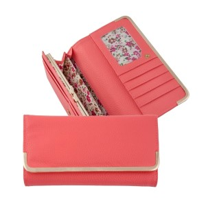 "Coral bi-fold wallet with a snap closure and gold tone hardware. Approximately 8"" x 4"" x 1"""