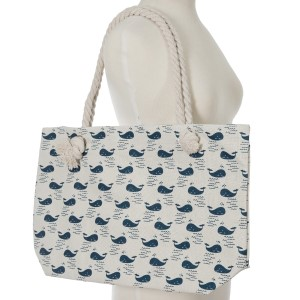 """Canvas tote bag with a top zipper and a whale print. 45% polyester and 55% cotton. Measures 20"""" x 12"""" in size with a 10"""" handle drop."""