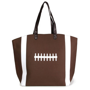 "Football tote bag is perfect for tailgating and monogramming. This bag features a snap closure, lined interior and interior pockets. 16"" x 19"" in size with a 10"" handle drop. 80% cotton and 20% polyester."