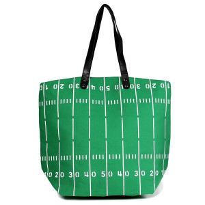 "Football field tote bag is perfect for tailgating and monogramming. This bag features a snap closure, lined interior and interior pockets. 16"" x 19"" in size with a 10"" handle drop. 80% cotton and 20% polyester."
