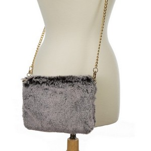 "Faux fur clutch purse with an inside zipper pocket and a gold tone chain. Approximately 9"" x 7"" in size."