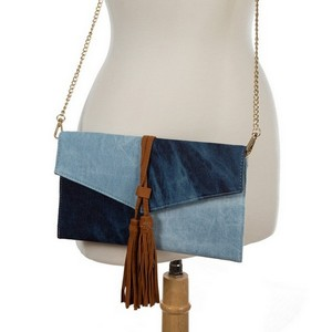 "Envelope, denim clutch bag with faux suede tassels and a gold tone shoulder chain. Measures 11"" x 6"" in size."