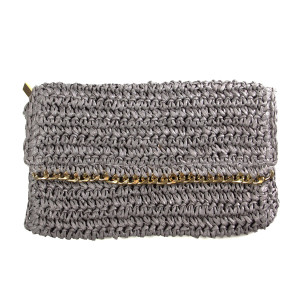 "Woven straw clutch with a magnetic and zipper closure, and gold tone accents. Measures 10"" x 6"" in size. 100% paper."