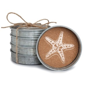 "Set of four metal coasters lined with cork and featuring a starfish. Measures 4"" in diameter."