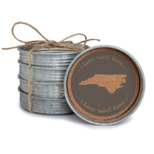 "Set of four ""Home Sweet Home"" North Carolina metal coasters. Measures 4"" wide and lined with cork."