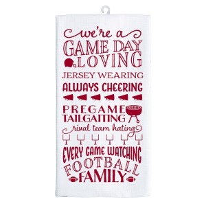 "Gameday tea towel in crimson and white, that reads ""We're a game day loving, jersey wearing, always cheering, pregame tailgating, rival team hating, every game watching, football family. Measures 25"" x 19"" when open."