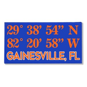 "Canvas wall art with the coordinates of Gainesville, FL in your team colors to show your school pride. Canvas measures 10"" x 1.5"" x 19."""