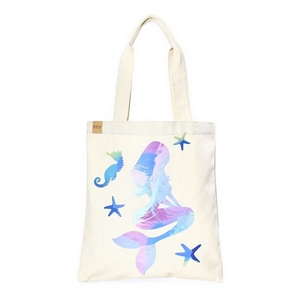 """Canvas tote bag with an inside pocket and a blue mermaid on the front. 100% cotton. Measures approximately 17"""" x 14"""" in size with an 11"""" handle drop."""