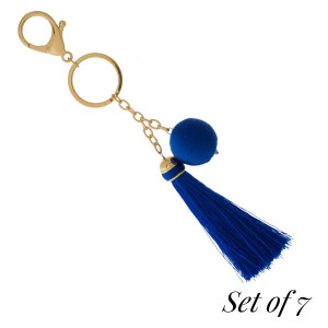 """Set of 7, gold tone keychains with a thread wrapped bead and thread tassel. Measures 6.5"""" in total length. Set comes with the following colors: royal blue, black, silver, gold, hunter green, rose gold, and burgundy."""