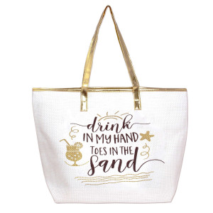 "White, ""Drink in my hand, toes in the sand"" tote bag with faux leather handles and a top zipper closure. 100% paper. Measures 20"" x 14"" in size."