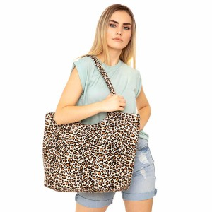 """Leopard print canvas tote bag.  - Zipper closure - One inside open pocket - Approximately 19.5"""" W x 14"""" T  - Strap length 12"""" - 65% Cotton, 35% Polyester"""