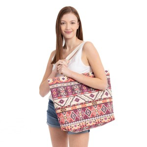 """Aztec print beach bag.  - Button closure - One inside open pocket - Approximately 20.5"""" W x 16"""" T  - Strap length 12"""" - 60% Cotton, 40% Polyester"""