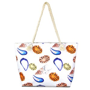 """Seashell tote bag with rope handles.  - Open inside pocket - Zipper closure - Rope handles - Approximately 22"""" W x 14"""" T - Handles 12"""" L  - 65% Polyester, 35% Cotton"""
