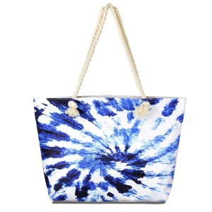 """Blue tie-dye tote bag with rope handles.  - Open inside pocket  - Zipper closure - Rope handles - Approximately 22"""" W x 14"""" T - Handles 12"""" L - 65% Polyester, 35% Cotton"""