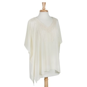 Cream lightweight poncho with fringe. 100% Polyester. One size fits most.