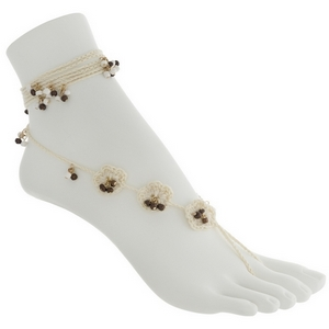 Set of two fashion foot jewelry anklets featuring ivory crochet flowers with brown and white bead accents.