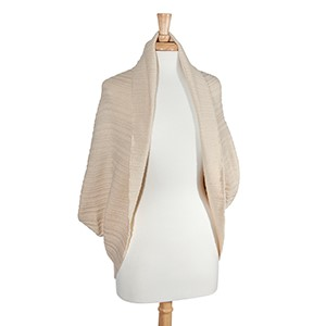 Ivory ribbed pattern cocoon kimono. 100% Acrylic. One size fits most.