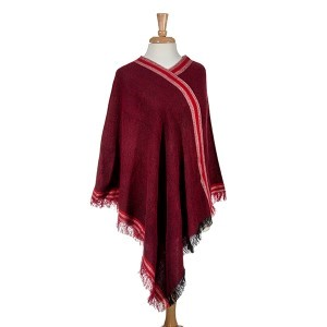 Red soft denim look poncho with fringe. 100% Acrylic. One size fits most.