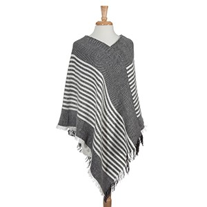 Black frayed edge stripe pattern poncho. 100% Acrylic. One size fits most.