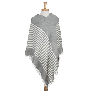 Gray frayed edge stripe pattern poncho. 100% Acrylic. One size fits most.