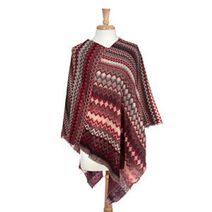 Red and brown abstract chevron pattern poncho. 100% Acrylic. One size fits most.