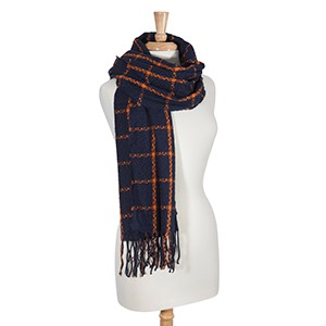 "Navy and orange check pattern oblong scarf. Can be worn as a shawl. 100% Acrylic. Approximately 26"" x 72""."