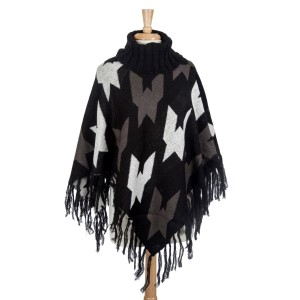 Black, gray, and white aztec printed turtle neck poncho with oversized houndstooth pattern. Made from 100% acrylic. One size fits most.