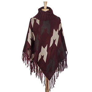 Burgundy, brown, and taupe aztec printed turtle neck poncho with oversized houndstooth pattern. Made from 100% acrylic. One size fits most.