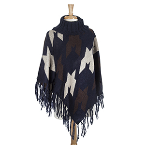 Navy, brown, and ivory aztec printed turtle neck poncho with oversized houndstooth pattern. Made from 100% acrylic. One size fits most.