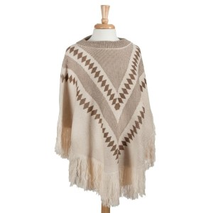 Ivory and brown tribal inspired poncho. 100% Acrylic. One size fits most.