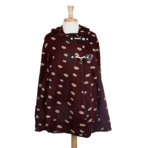 Burgundy hooded polka dot cape with toggles. 95% Polyester and 5% Spandex. One size fits most.